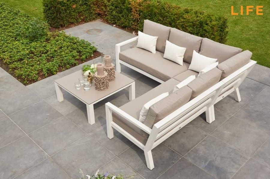 Timber outdoor corner lounge set with white powder-coated aluminium frame. Cushions in picture are similar in look to actual cushions supplied by Poynters. But our cushions have been upgraded to premium Sunbrella Fabric in Natte grey. There is also available, a single arm-less sofa to make the corner sofa longer, and arm chairs and 2.5 person sofa in the range. The coffee table displayed is not available. We have Leaf tables available.