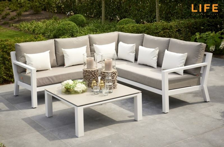 Timber outdoor corner lounge set with white powder-coated aluminium frame. Cushions in picture are similar in look to actual cushions supplied by Poynters. But our cushions have been upgraded to premium Sunbrella Fabric in Natte grey. There is also available, a single arm-less sofa to make the corner sofa longer, and arm chairs and 2.5 person sofa in the range. The coffee table displayed in the picture is NOT included or available. We have Leaf tables available.