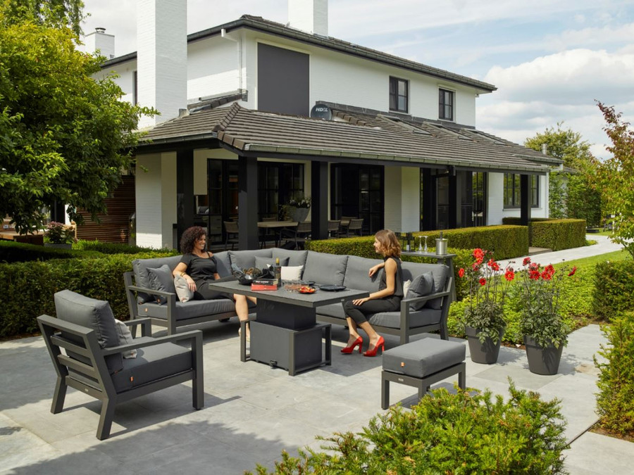 Timber outdoor corner lounge set with lava powder-coated aluminium frame. Cushions in picture are similar in look to actual cushions supplied by Poynters. But our cushions have been upgraded to premium Sunbrella Fabric in Natte charcoal. This picture shows an optional single arm-less sofa to make the corner sofa longer, and an optional arm chair. A 2.5 person sofa is also available in the range. The coffee table displayed is not available. We have Leaf tables available.