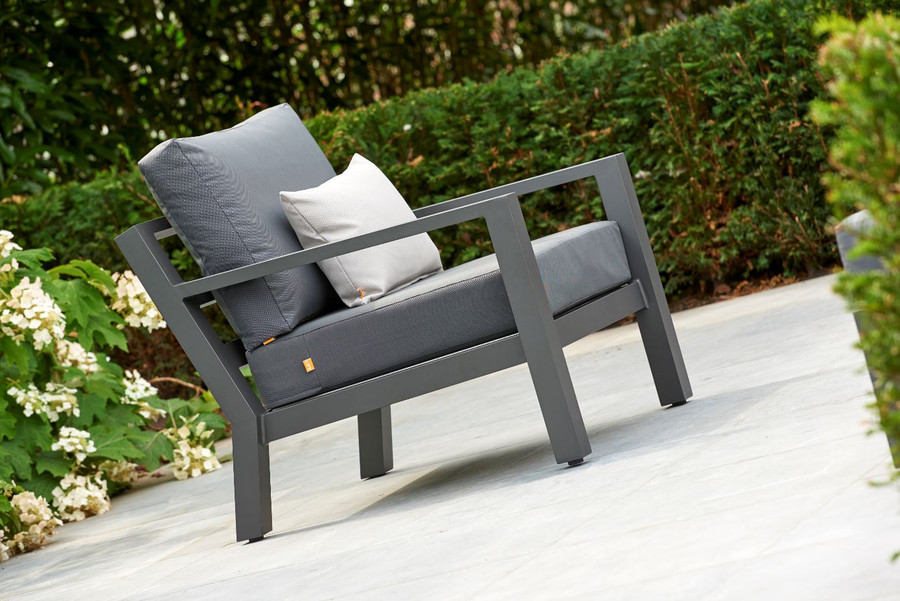 The Alu Timber outdoor lounge chair by Life is supremely comfortable and has a decent seat height of 44cm. Made from fully welded aluminium, it is strong and durable. Lava powder-coat finish with Sunbrella Natte Charcoalcushions. Note :  cushions in image are indicative only. Actual supplied cushions are Sunbrella Natte Charcoal - a premium outdoor fabric. Chair includes seat  cushion and back cushion only.