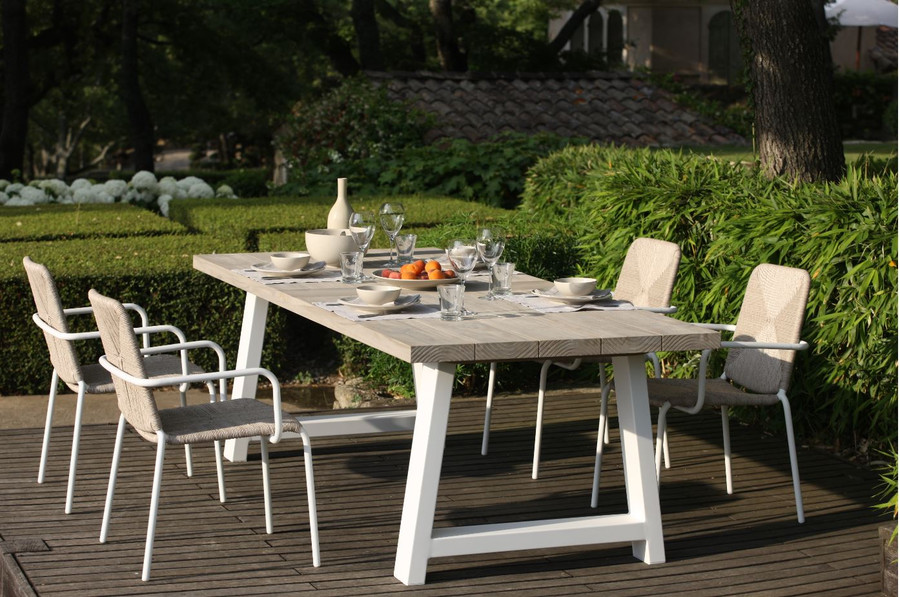Outdoor Beach table with teak drift finish table top and galvanized and powder-coated legs in stone white finish.