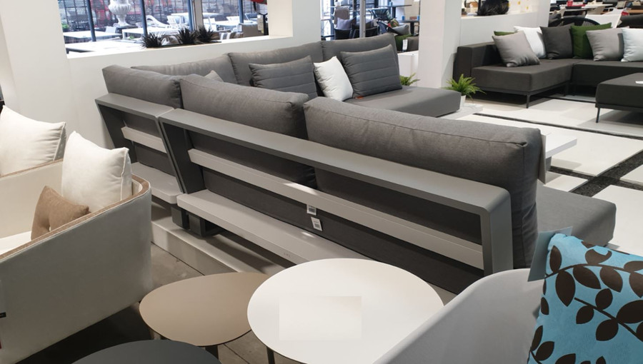 In store presentation of Bora Bora outdoor corner lounge - back - note back is 2 tone grey and white
