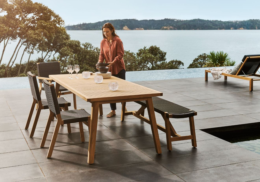 Devon Sawyer teak outdoor bench 180cm in shadow grey, matched with Devon Porter table