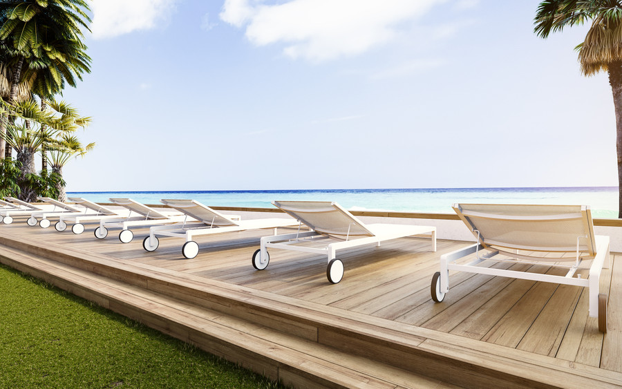 Another ambient image of Ella sun lounger in white powder-coated aluminium with Batyline mesh
