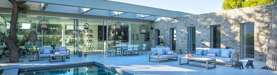 Skaal outdoor sofa and dining collection by Les Jardins. Scatter cushions available separately.
