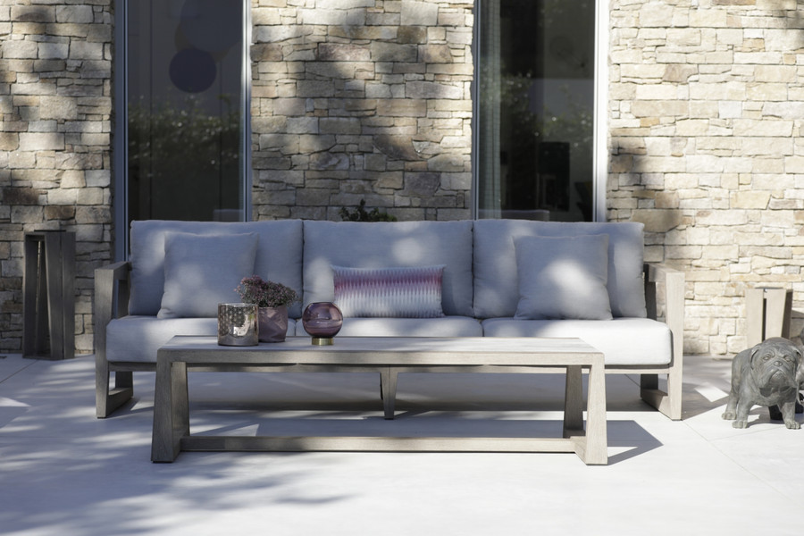 Skaal 3 person outdoor teak sofa - ambient image with Skaal outdoor coffee table, Scatter cushions available separately.