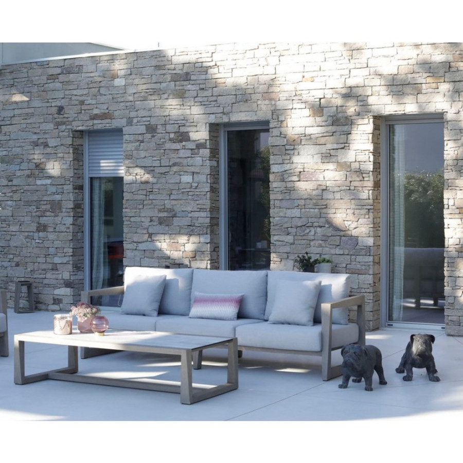 Skaal 3 person outdoor teak sofa - ambient image with Skaal outdoor coffee table. Scatter cushions available separately.