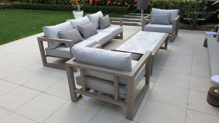 Full Skaal outdoor lounge set in situ on North Shore. Shown with Sunbrella Natte Grey cushions.