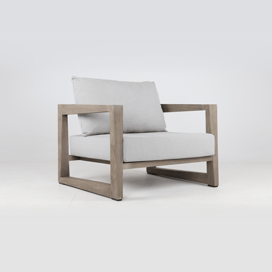 Skaal outdoor teak low chair by Les Jardins. Scatter cushions available separately.
