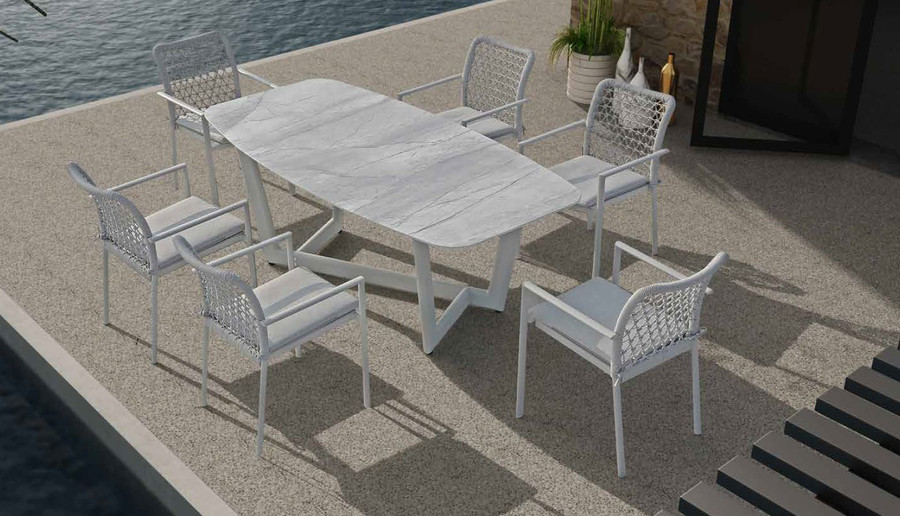 Club outdoor pedestal table by Couture. Aluminium frame and ceramic top. Shown with matching, stackable club dining chairs