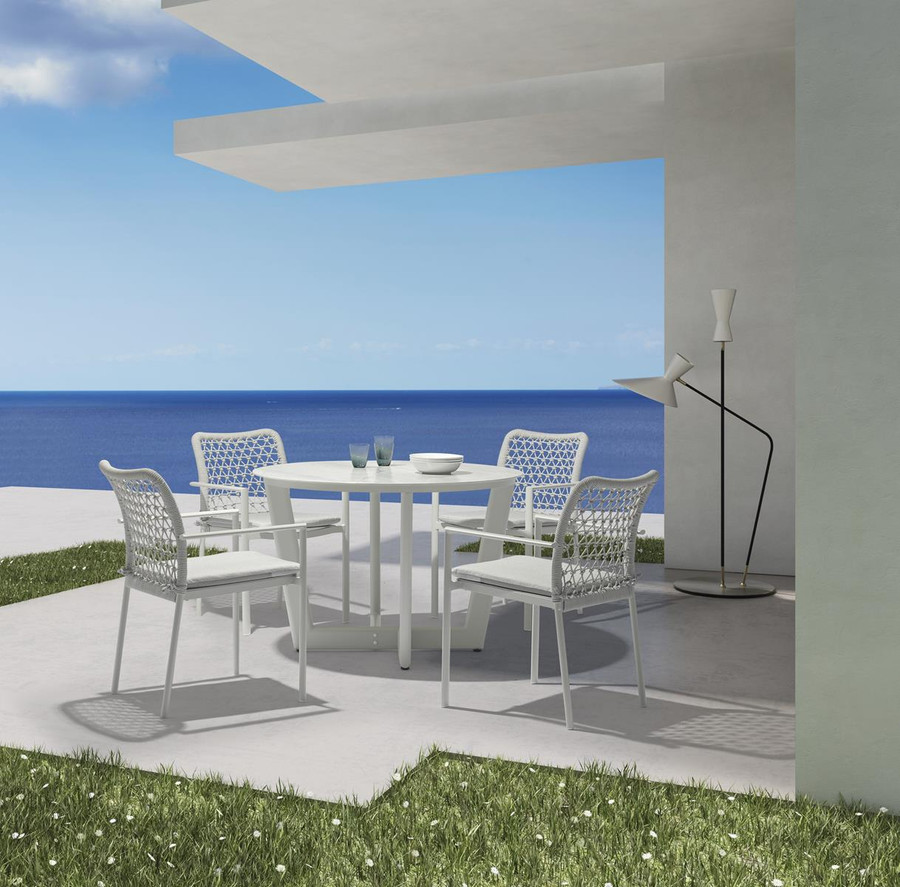 Club round outdoor table by Couture with matching Club outdoor stackable dining chairs