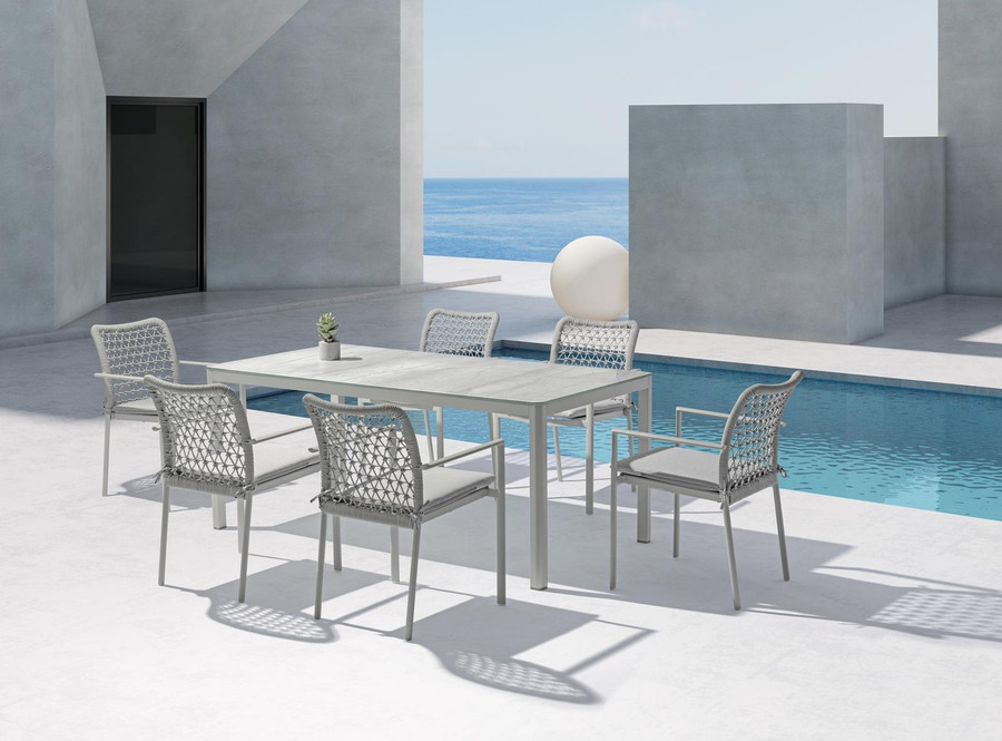 Club outdoor aluminium and rope stackable dining arm chair, with seat squab. Shown in situ with a matching rectangular table from the Club dining table range.