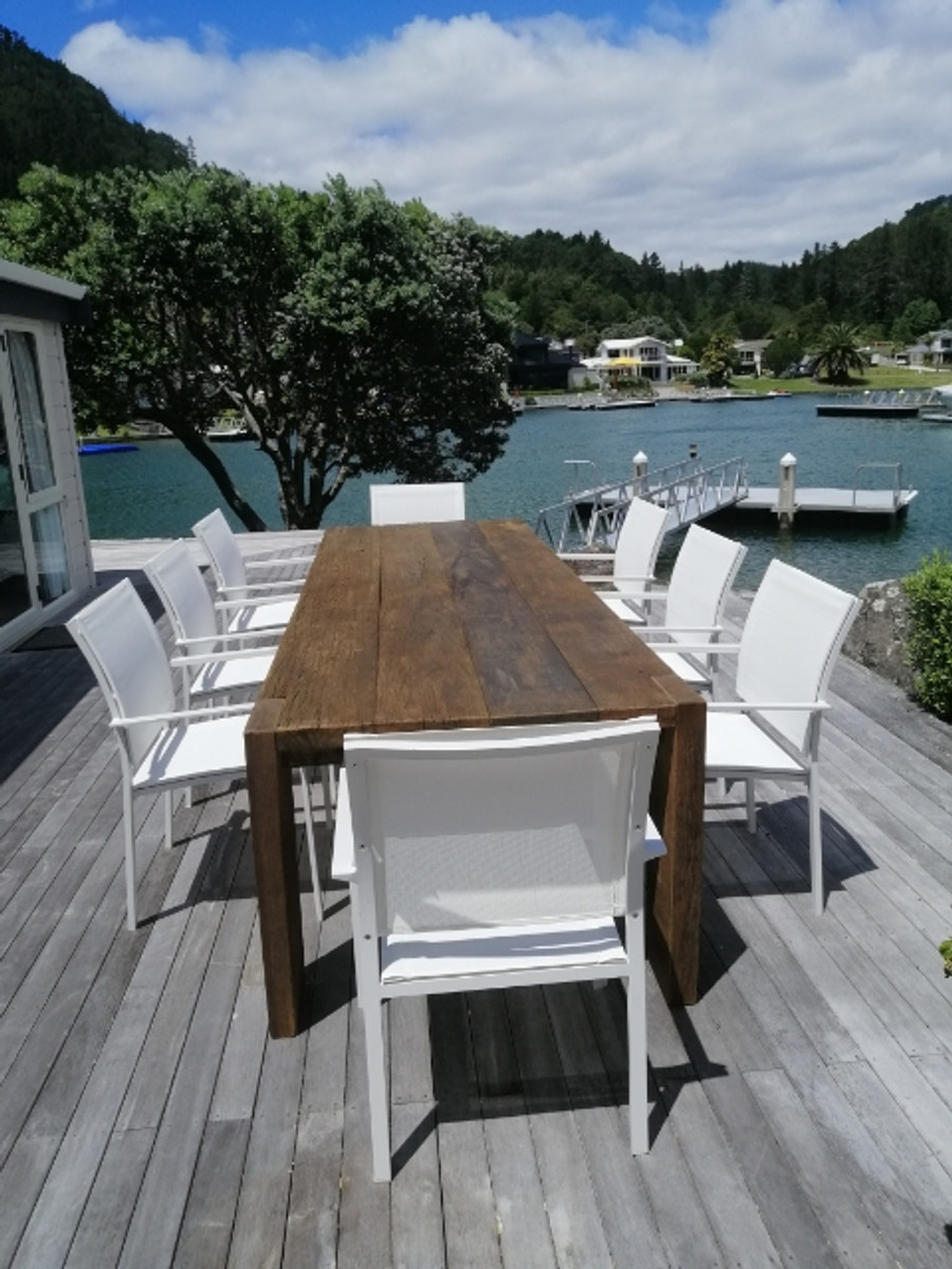 3m Railwood outdoor table and white Orlando dining chairs in Pauanui