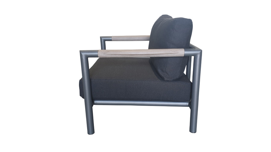 Side view of Bastingage outdoor low lounge chair in powder-coated aluminium with teak accents and Sunbrella cushions.