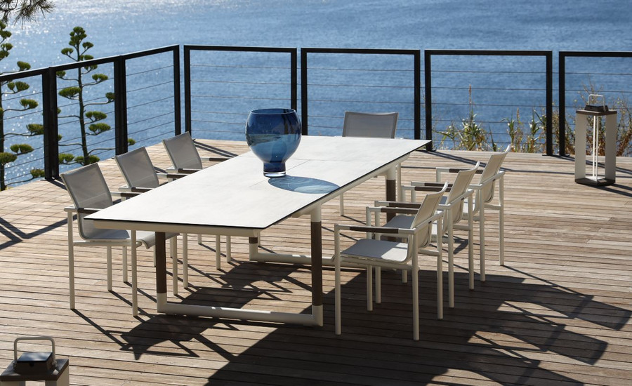 Bastingage outdoor extension table by Les Jardins with white frame and faux concrete beton HPL top - shown with matching Bastingage dining chairs Picture shows table fully extended (200cm closed, 300cm open)