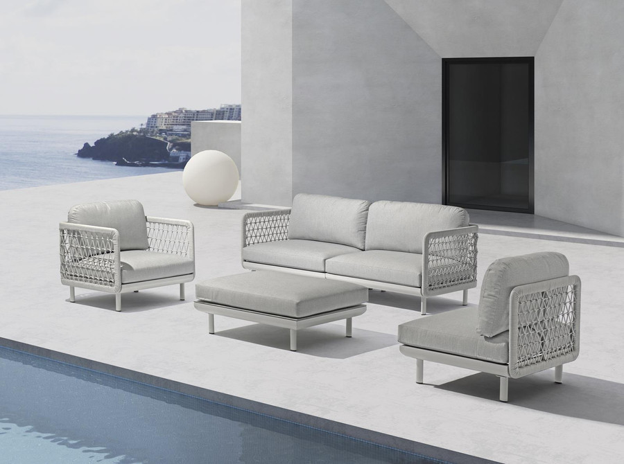 Club outdoor modular sofa series by Couture shown from left to right as follows : Club lounge chair - club left arm sofa - club right arm sofa - club single sofa. Modular sofa modules in a fully re-configurable design.