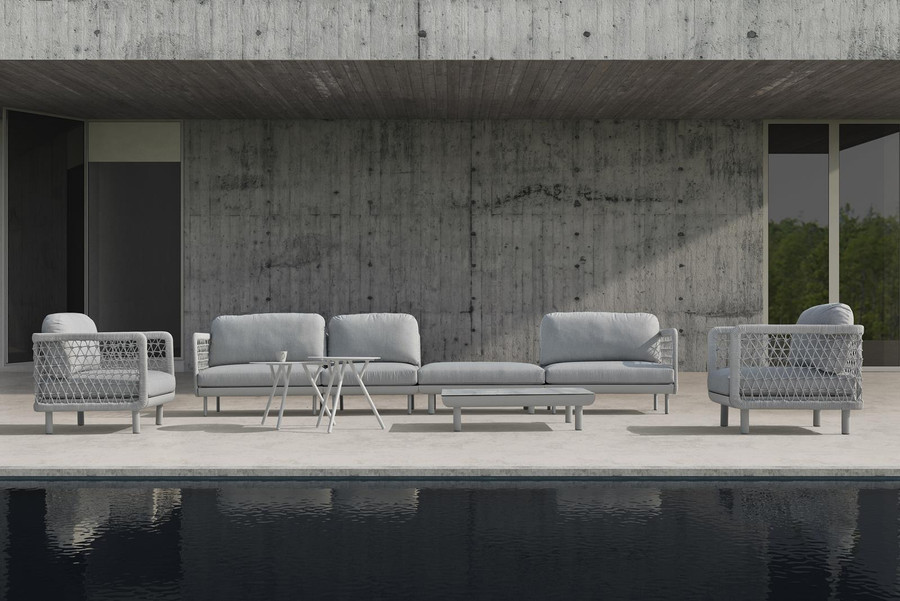 Club outdoor modular sofa series by Couture shown from left to right as follows : Club lounge chair - club left arm sofa - club single sofa - club ottoman - club right arm sofa - club lounge chair. Modular sofa modules in a fully re-configurable design.