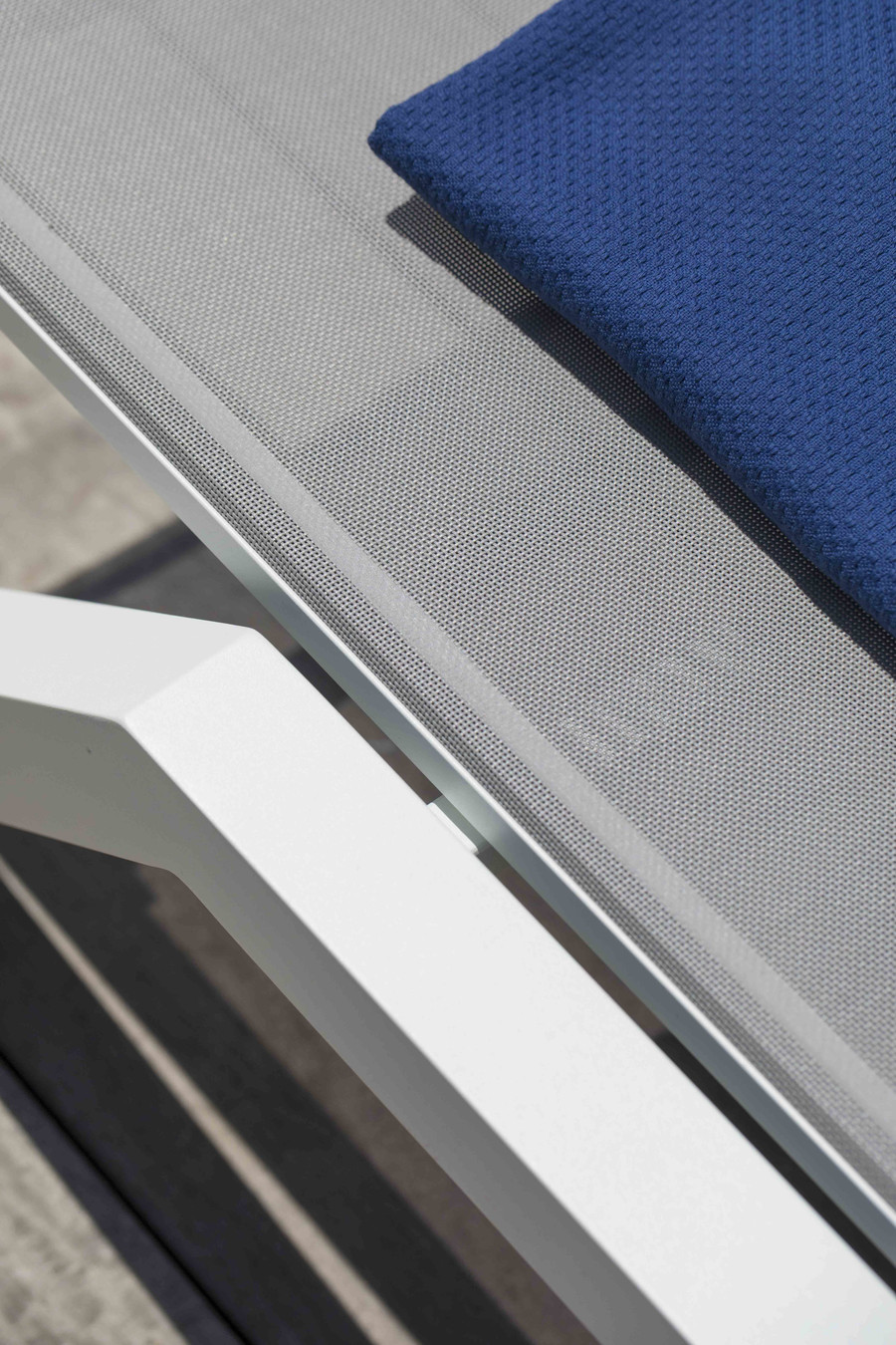 Close up of frame of Amaka outdoor sun lounger - please note the white frame version is supplied with white batyline mesh
