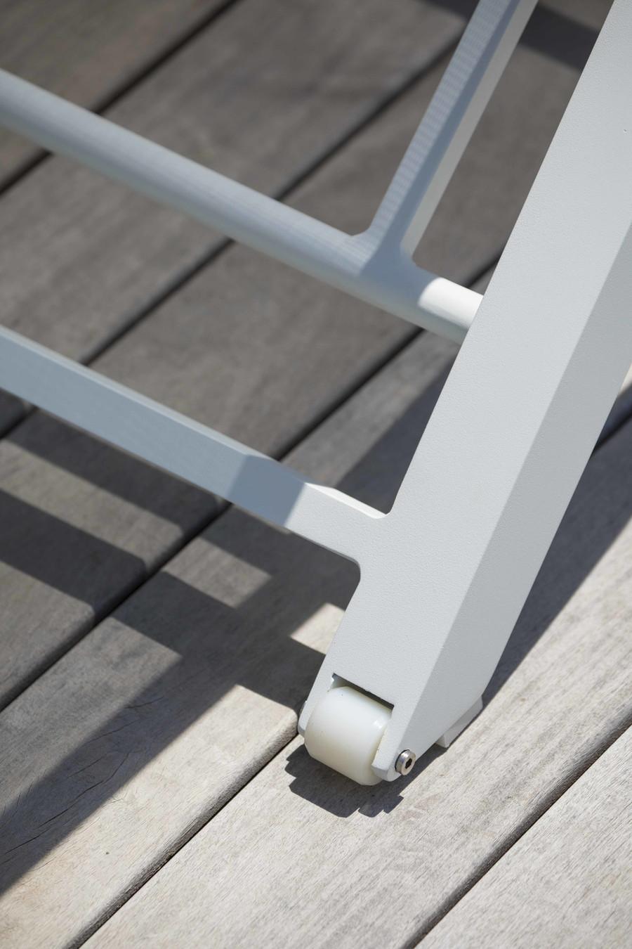 Discrete wheels at rear of Amaka outdoor sun lounger
