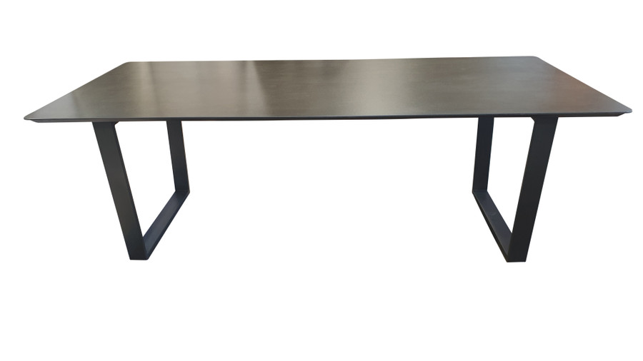 Side view of Alabama ceramic top outdoor dining table with graphite frame