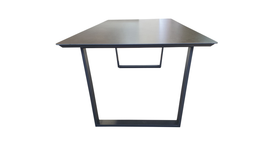 End view of Alabama ceramic top outdoor dining table with graphite frame
