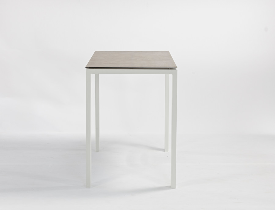 End view of Poly Ceramic top and aluminium frame outdoor bar table in 2 colour ways. Size 150x80x108H. Table shown is white frame.
