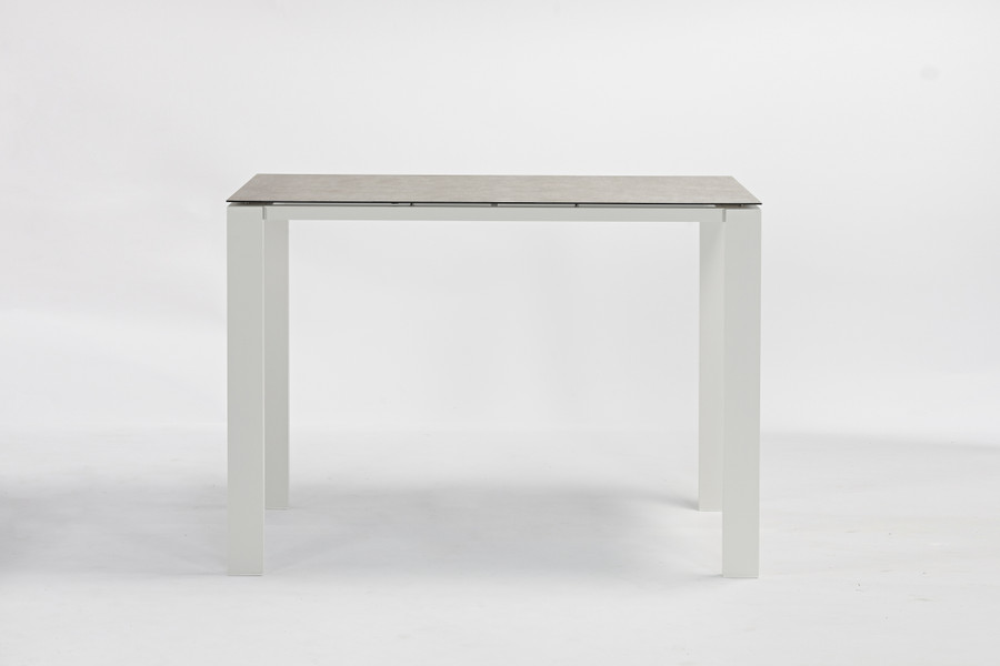 Side view of Poly Ceramic top and aluminium frame outdoor bar table in 2 colour ways. Size 150x80x108H. Table shown is white frame.