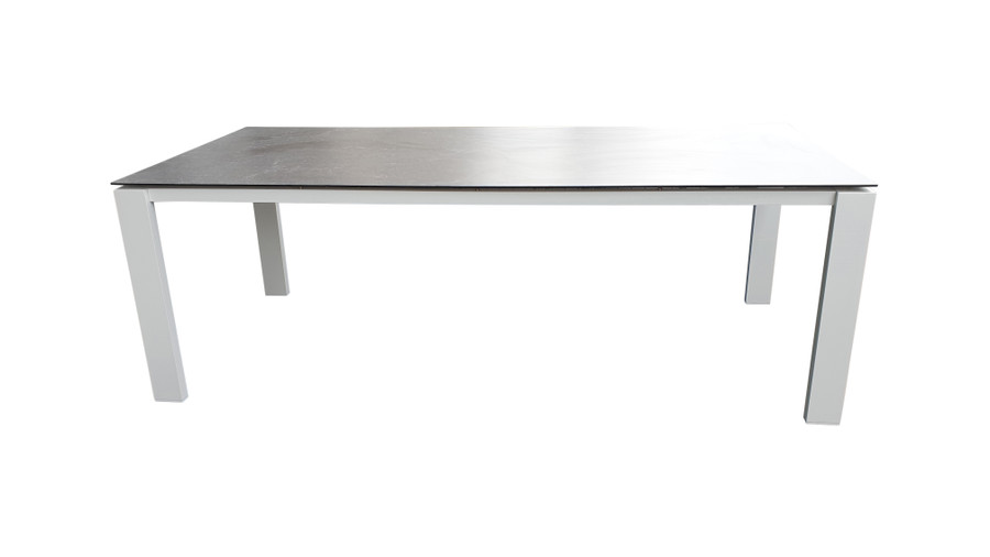 Side view of Poly Ceramic top and aluminium frame outdoor dining table in 2 colour ways. Size 220x100 shown as reference to design only. Table shown is white frame with dark grey ceramic top.