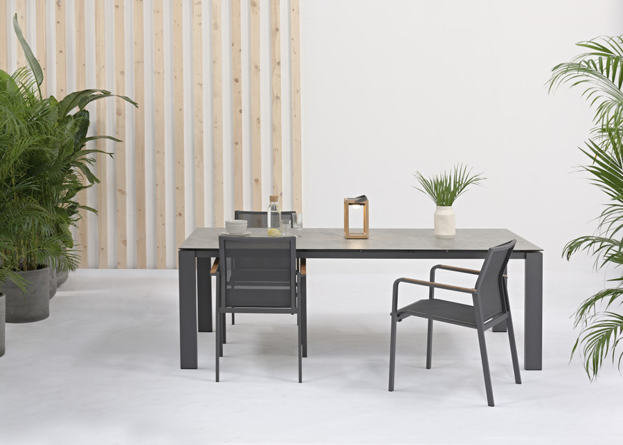 In situ view of Poly Ceramic top and aluminium frame outdoor dining table in charcoal frame with light grey ceramic top. Size shown is 220x100 shown for reference only to design.