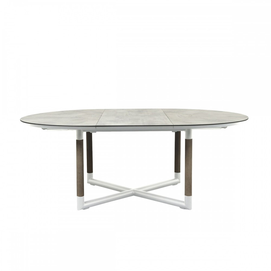 Bastingage outdoor round extension table with HPL (high pressure laminate) top and aluminium frame, with teak accent legs. Shown in extend size 146x206cm