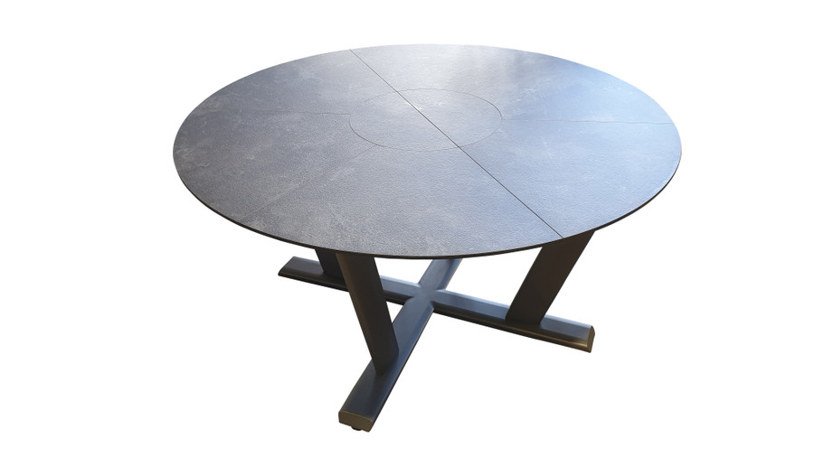Hegoa Round extension table by Les Jardins in closed position. 146cm diameter, it extends to 206cm x146cm when extended. Faux HPL slate top with space grey pedestal base.