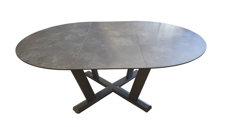 Hegoa Round extension table by Les Jardins in extended position. 146cm diameter, it extends to 206cm x146cm when extended. Faux HPL slate top with space grey pedestal base.