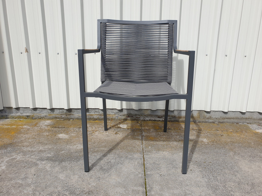 Front view of Ribbon dining arm chair in grey colour