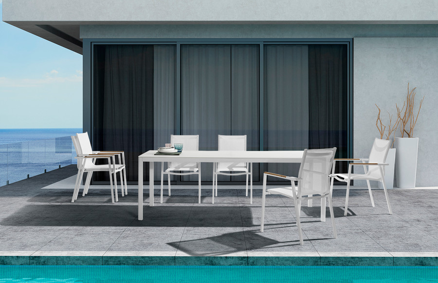 In situ picture Ella outdoor dining table with white powder-coated aluminium frame and white etched glass top. Please note these chairs are not available.