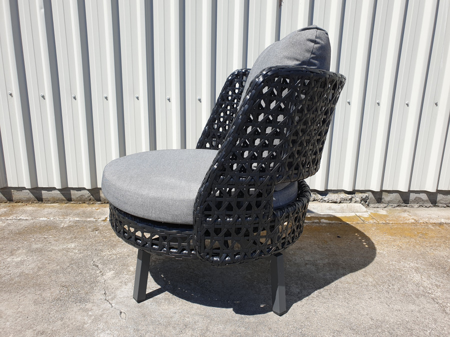 Side view of Tiki outdoor swivel chair. Powdercoated aluminium frame and black synthetic wicker