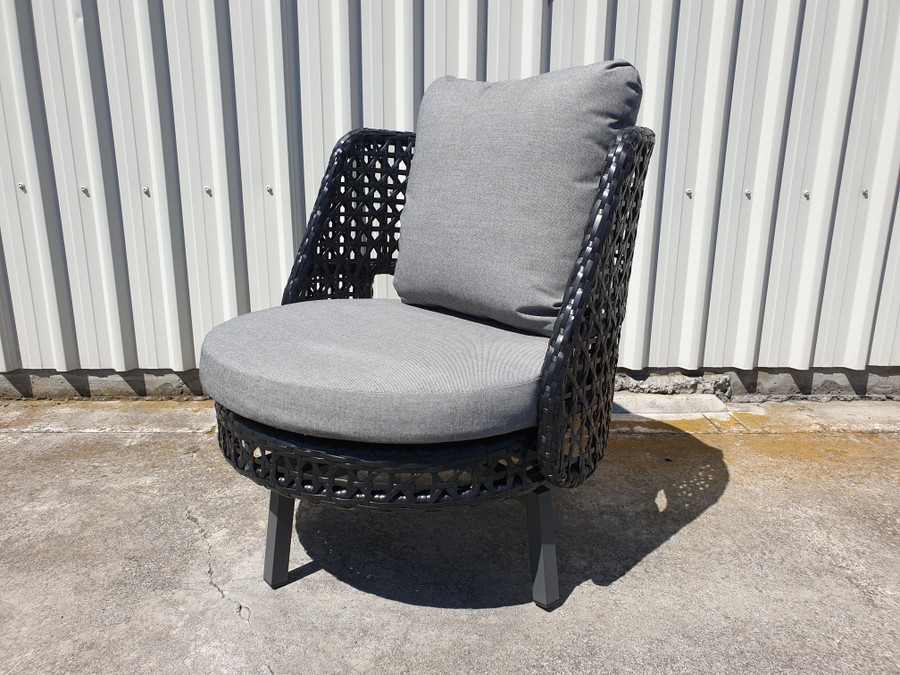 Angle view of Tiki outdoor swivel chair. Powdercoated aluminium frame and black synthetic wicker