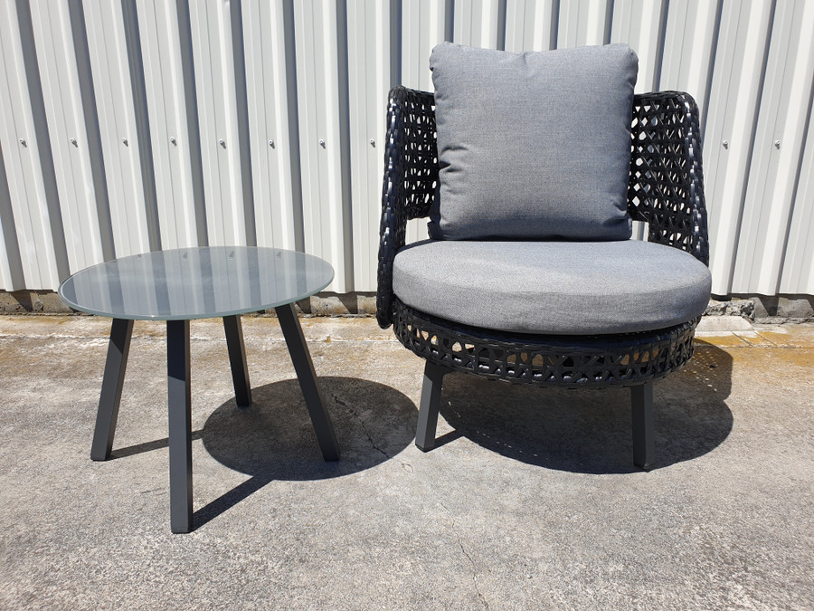 Tiki outdoor swivel chair. Powdercoated aluminium frame and black synthetic wicker. Shown with matching Tiki table - small