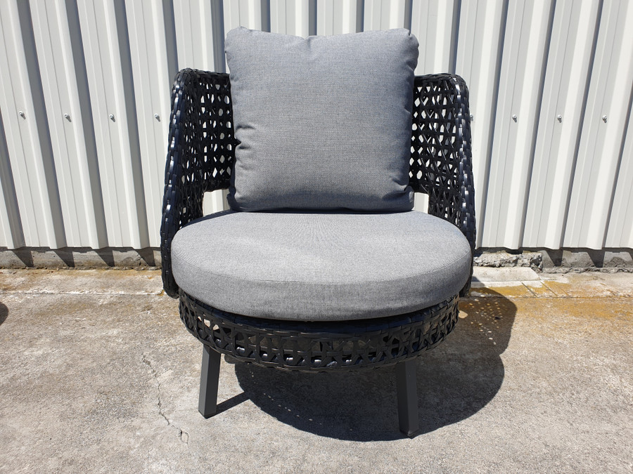 Front view of Tiki outdoor swivel chair. Powdercoated aluminium frame and black synthetic wicker