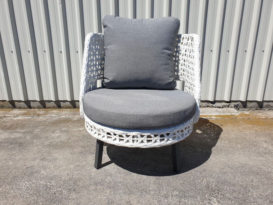 Frontl view of Tiki outdoor swivel chair in white wicker with outdoor cushions.