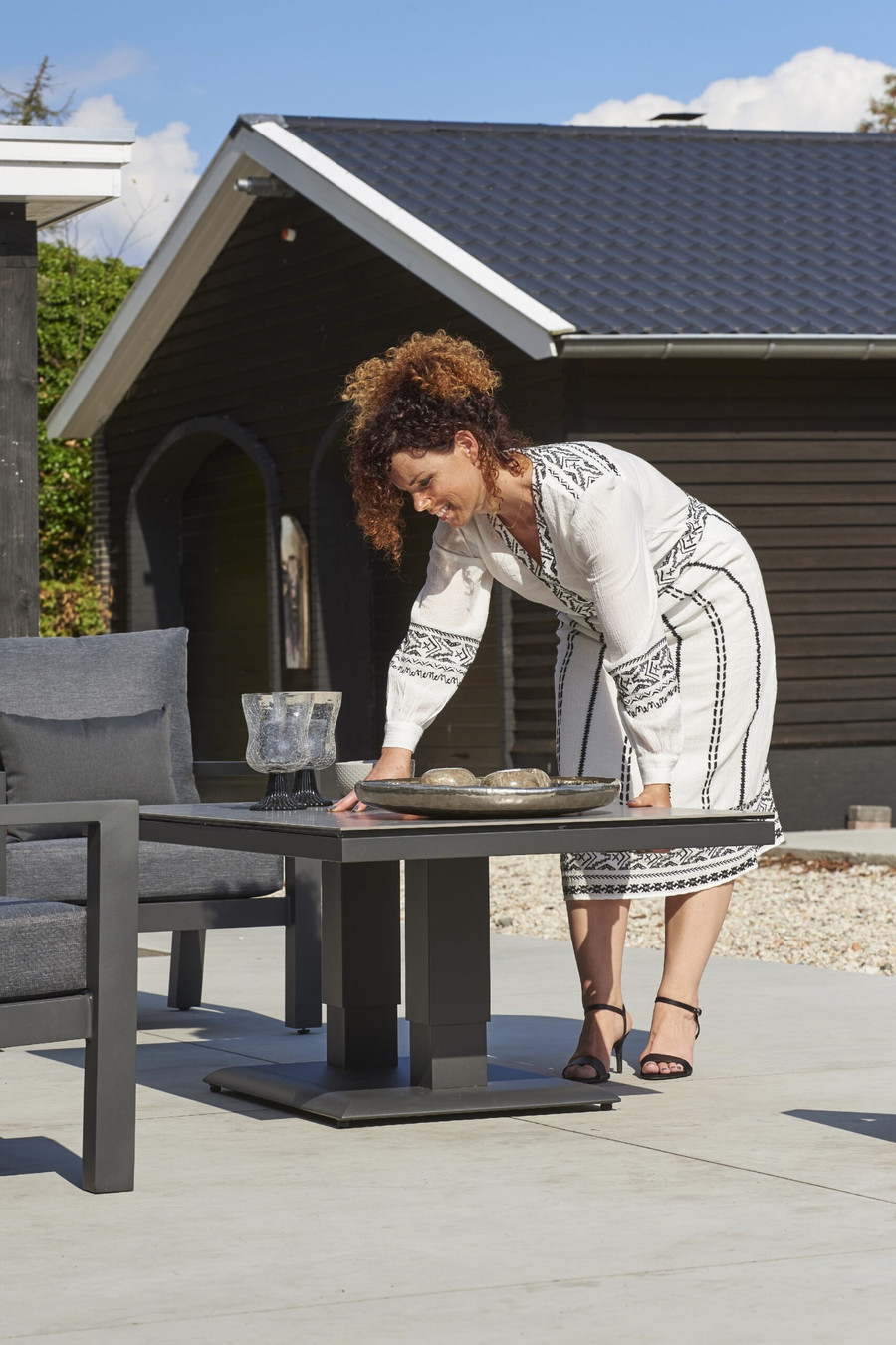 Zeb height adjustable outdoor coffee table - shwon at its lowest setting. Adjust the height from 51cm to 73cm