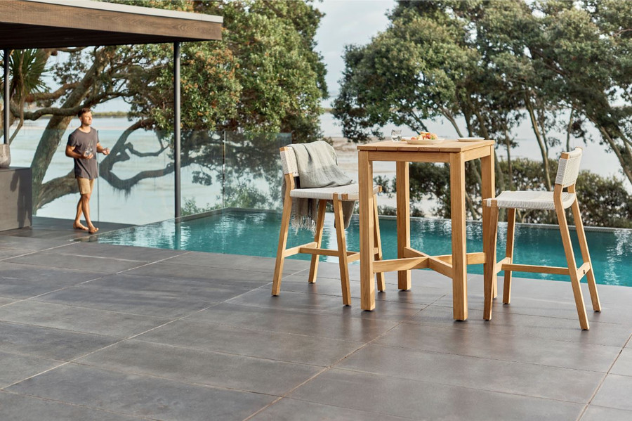 Devon Haast  outdoor bar table in durable teak looks great with the matching Jackson outdoor bar stools