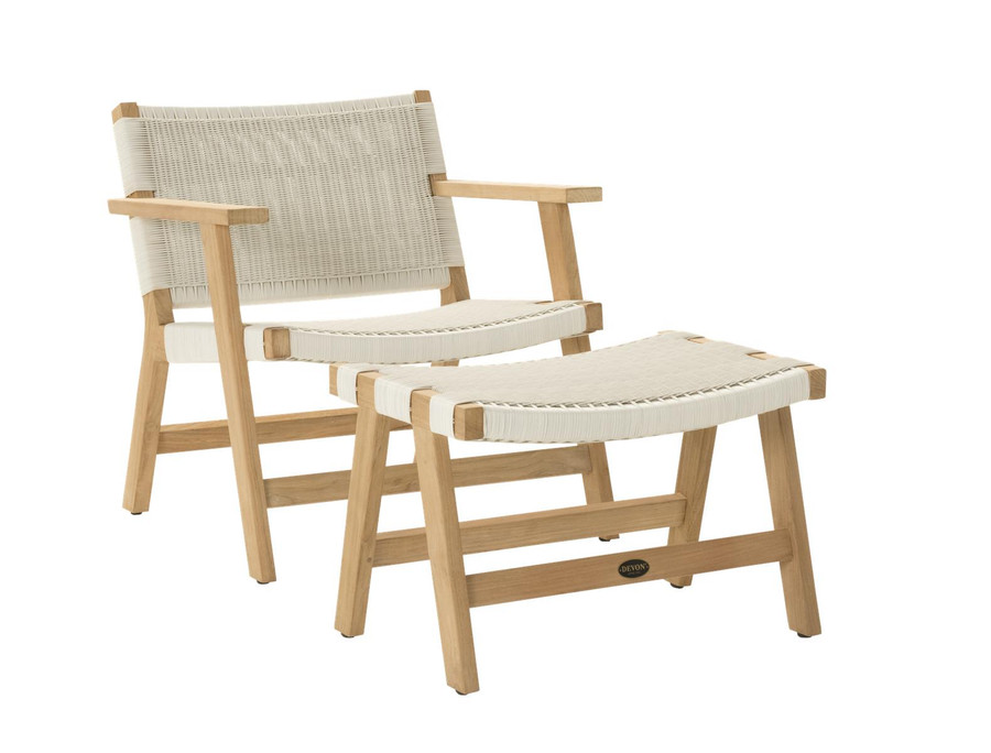 Angle view of Devon Jackson outdoor easy chair in whitewash wicker with matching footstool