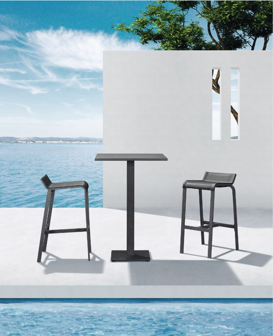 Luis outdoor bar stool in black. Shown with matching Iris Bar table.