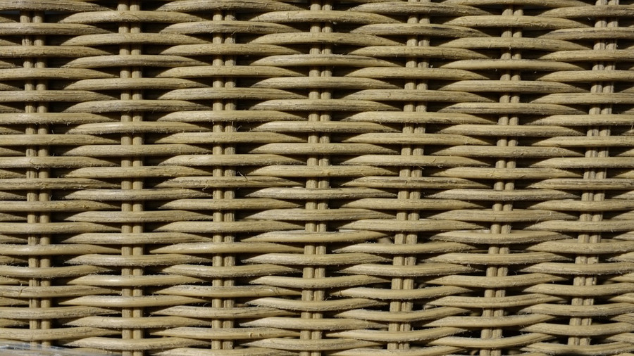"""high resolution image of wicker, displaying natural looking cane characteristic with """"rough"""" surface texture. brushed amber"""