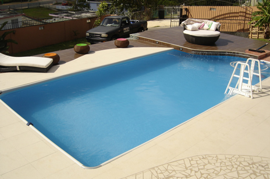Pool set in an aboveground deck. The patented support structure makes it possible to build a deck around the pool as there are fewer structure impediments than a typical portable pool. Note : the pool cannot be sunk in to the ground.