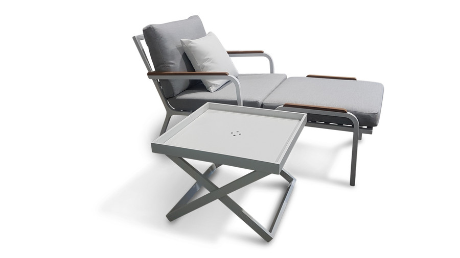 this picture shows the size of the folding table against our Sanibel lounge chair and ottoman
