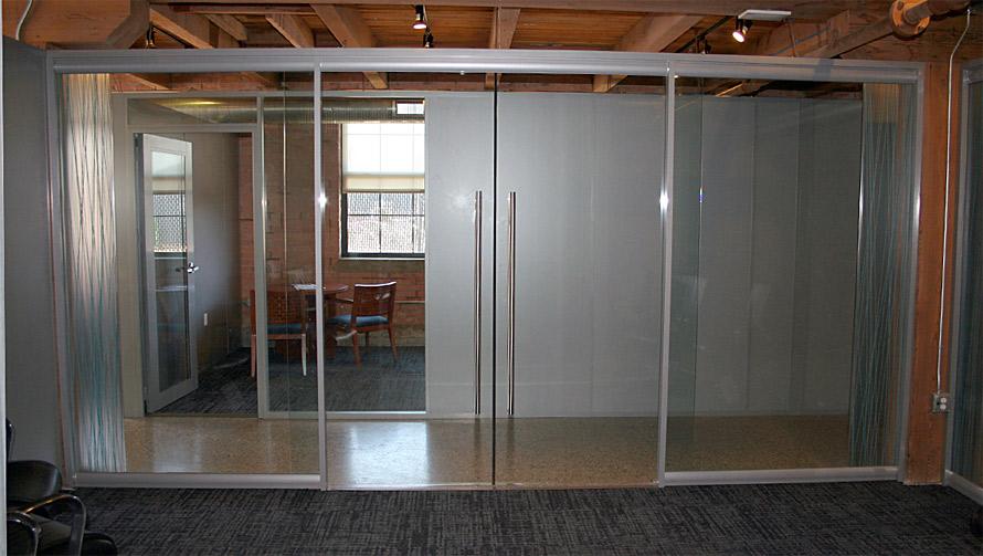 double-frameless-glass-sliding-conference-room-doors.jpg