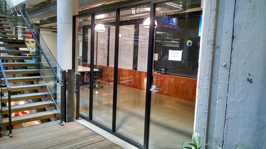 freestanding-glass-conference-room-black-framing-ford-field-detroit-mi.jpg