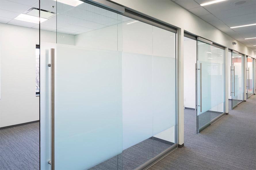 glass-office-walls-with-soft-closing-sliding-glass-door-hardware.jpg