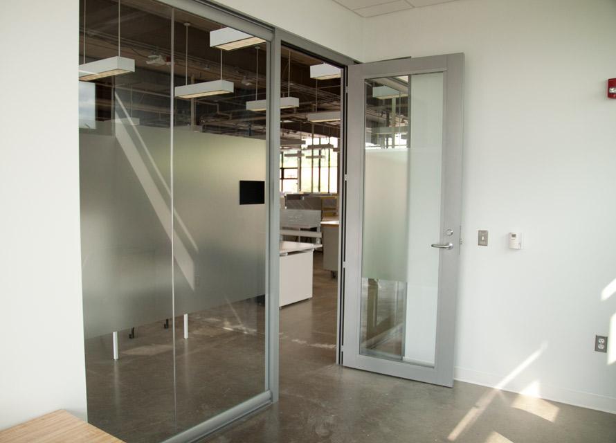 manasota-office-supplies-llc-aluminum-framed-glass-door-with-wingback-sidewall-view-series.jpg